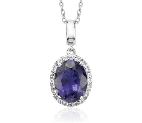 Amazing Blue Topaz Tp 595 oval iolite and white topaz halo pendant in sterling
