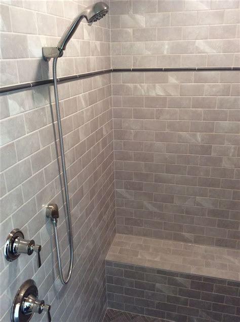 walk  shower   grey subway tile metal pencil