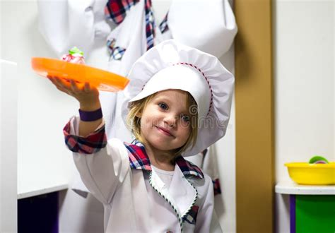adorable  girl playing chef cooking stock image
