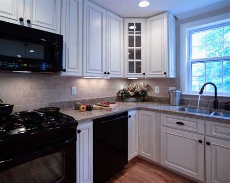 kitchen ideas with black appliances white kitchen with black appliances design pictures