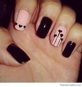 Black and light pink nail design with hearts