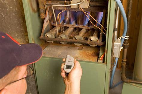 inspect  gas furnace pilot light