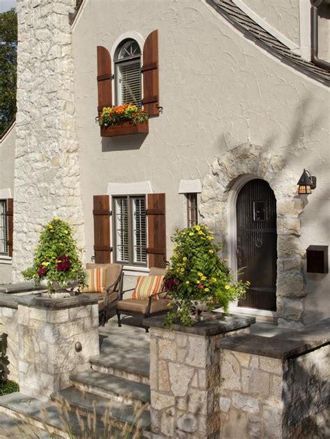 love  shutters  window box stucco stone home