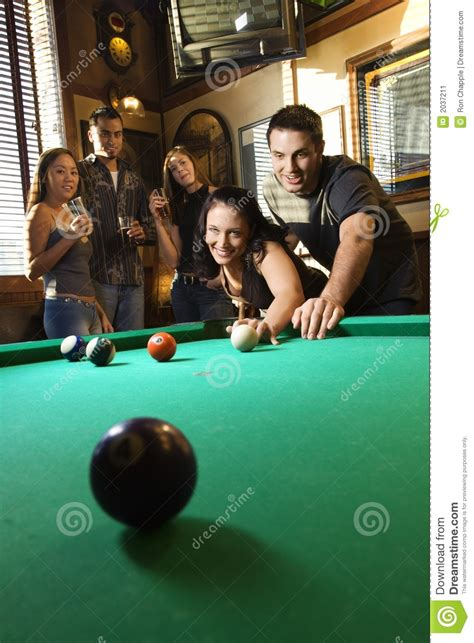 group  young adults playing pool stock image image