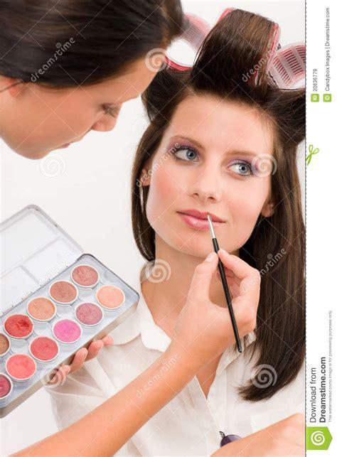 artist woman fashion model apply lipstick royalty
