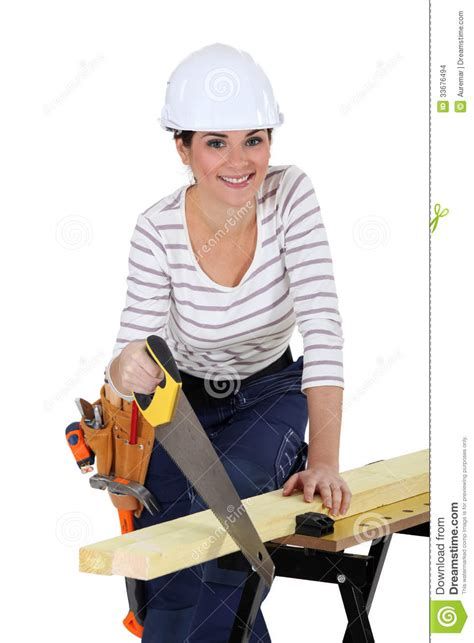 woman sawing wood stock photo image  gray objects