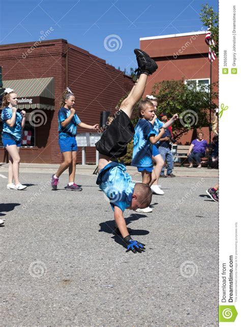 acrobatic boy walks  hands editorial stock photo