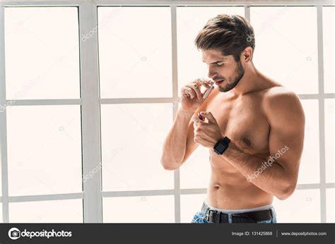 guy sexy sexy guy smoking at home stock photo 169 iakovenko123
