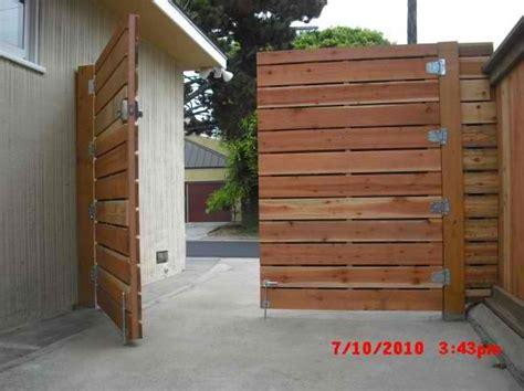 wooden driveway gates  redwood modern horizontal