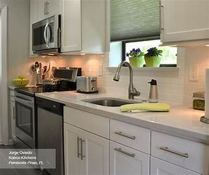 White Shaker Style Cabinets in a Galley Kitchen - Homecrest