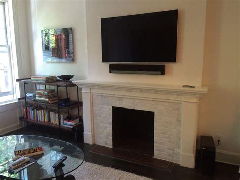 tv above fireplace setup