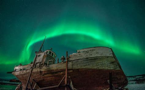 aurora borealis northern lights night green stars boat