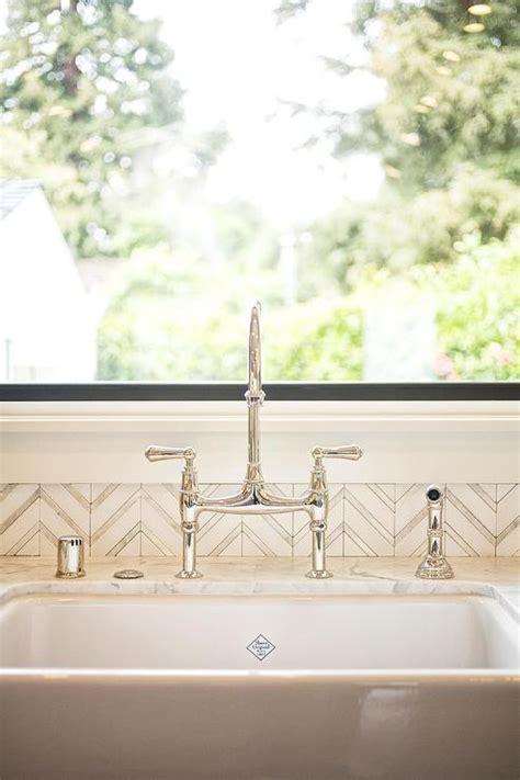 white  silver herringbone tile backsplash