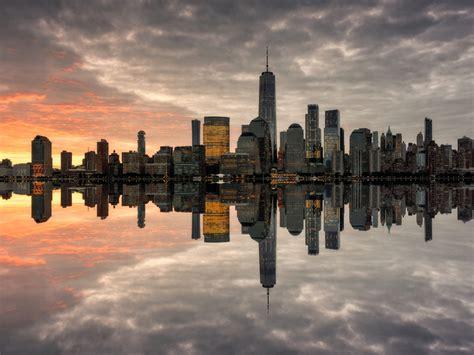 manhattan skyline   populated  york city sunnset reflection   water miror ultra