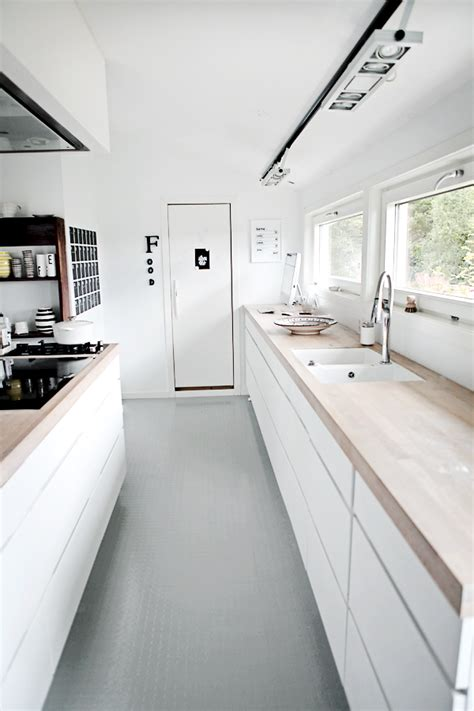 rubber flooring for kitchens the grey rubber floor against the white units and 4931