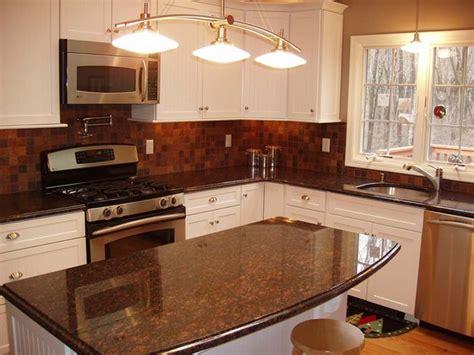 white kitchen cabinets with brown countertops slate backsplash amp granite countertop tan amp brown 734 | 3bcabd99f9568be07546ecff8b42795e off white cabinets cream cabinets