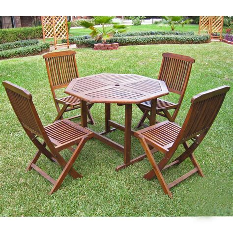Wooden Patio Table And Chairs by Stow Away Wooden Table With 4 Folding Chairs In Patio