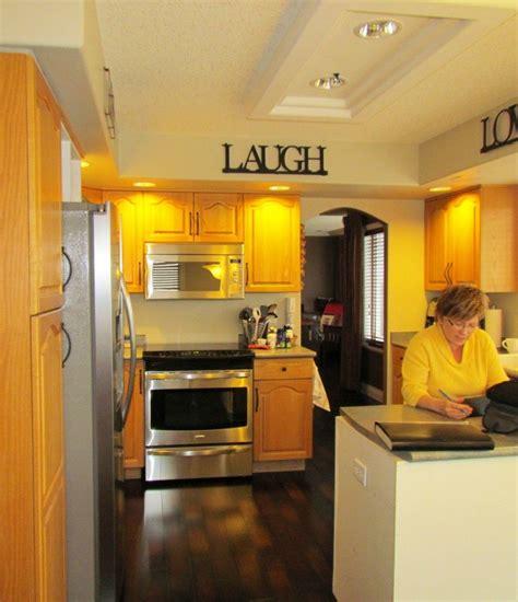 oak kitchen remodel painted cream cabinets  quartz