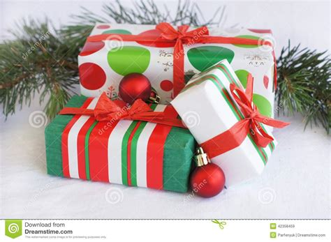 Three Red-green-white Christmas Gifts With Red Orn Stock