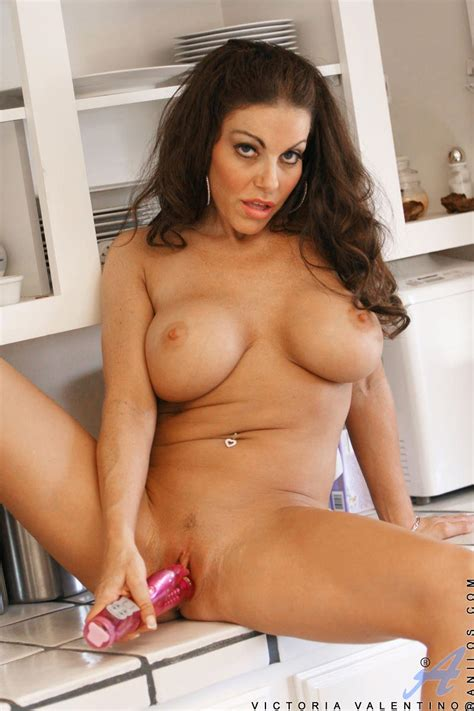 Naughty Tanned Brunette victoria valentino With Massive Boobs Plays With A Toy In The Kitchen