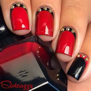 Red and black nail design with hearts dots