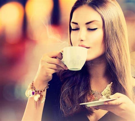 girl drinking tea  coffee stock photography image