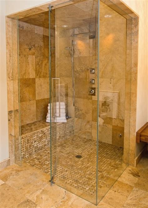 Light stone tile frameless shower   Contemporary
