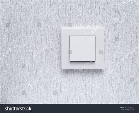light switch white light switch on white wall concept