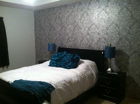 l for bedroom bedroom bedroom decor with wallpaper and brown bed platform