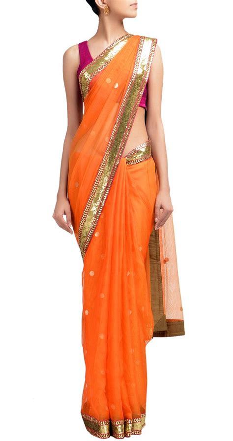 Harga Sari Gold sabyasachi orange chanderi sari with gold sequin border