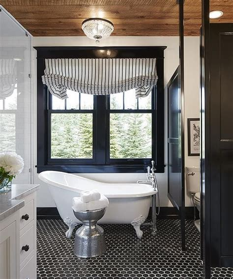 black casement windows wood ceiling black floor tile beautiful bathrooms bathroom design