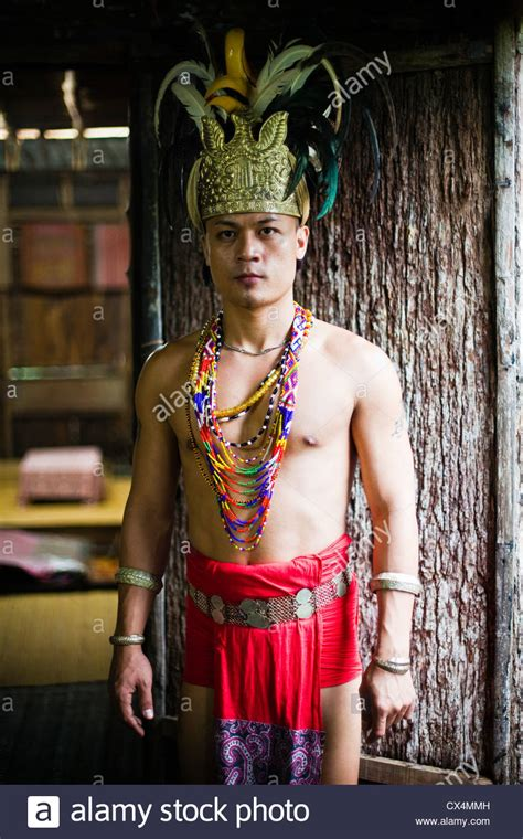Iban Man In Traditional Dress At The Sarawak Cultural