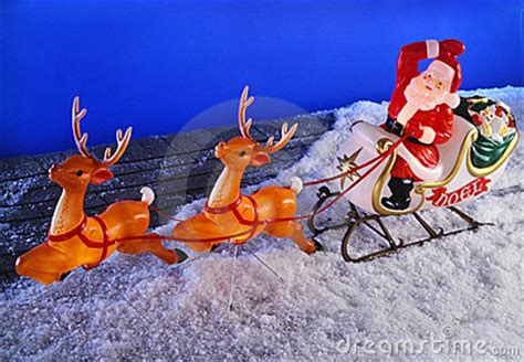 santa clause and reindeer on roof royalty free stock