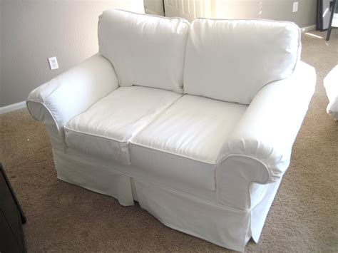 white slip covered sofa sofa cover white how to cover a chair or sofa with loose