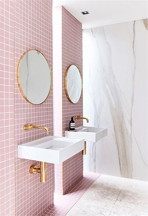 gorgeous pink tiled bathroom  gold hardware
