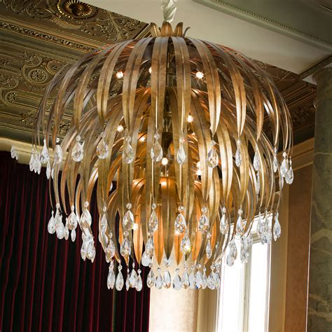 Large Round Antiqued Bronze Crystal Chandelier  Juliettes. Small French Doors. Modern Toaster. Panel Molding. Shimmer Rug. Blue Garage Door. Hayworth Collection. Wicker Bar Stool. Rustic Media Cabinet