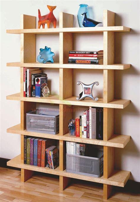 desain lemari buku modern bahan kayu jati aneka model