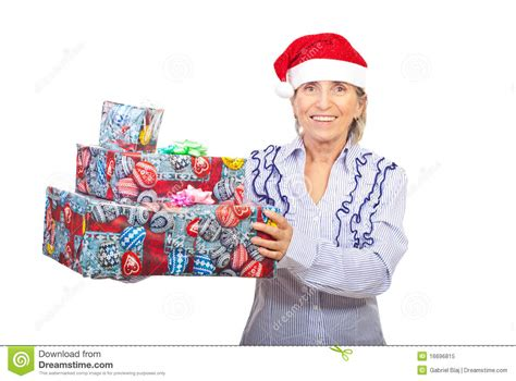 senior woman holding christmas gifts royalty free stock
