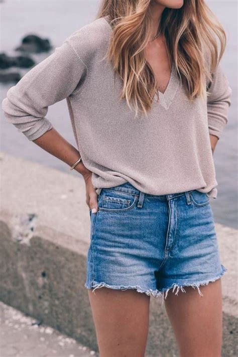 Picture Of blue denim shorts and a neutral long sleeve with a V cut