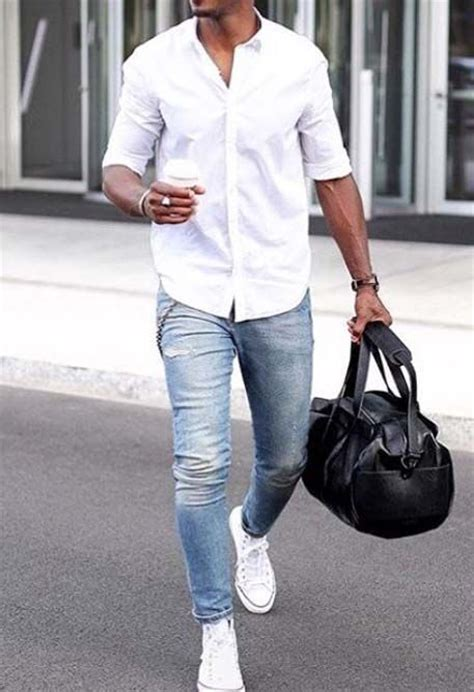 Picture Of light blue jeans, a white shirt and white sneakers