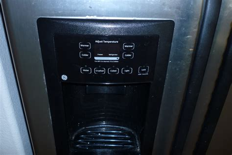 fix frozen water  dispenser   ge refrigerator