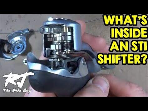 what s inside a shimano sti shifter how do sti shifters work youtube
