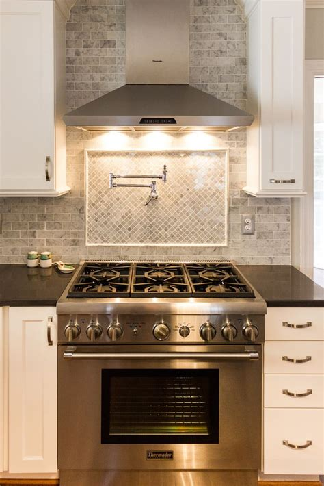 kitchen range backsplash white kitchen with marble subway tile and tile backsplash 2479