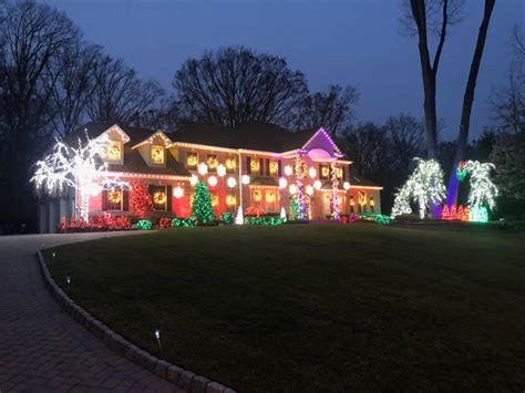 holmdel home s christmas light show set to music is a must