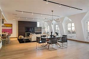 Exclusive new york city penthouse blends tribeca style for Track lighting in living room