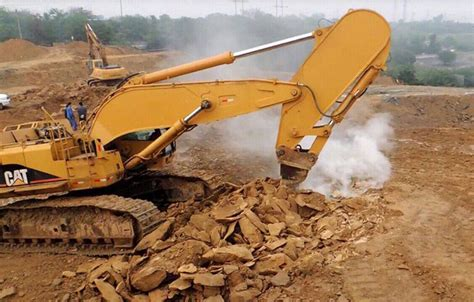 shortened excavator rock boom arm high efficient attachment  breaking weathered granite