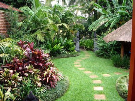 tropical style gardens beautiful lush full borders with curves note how the stone path follows the curved borders