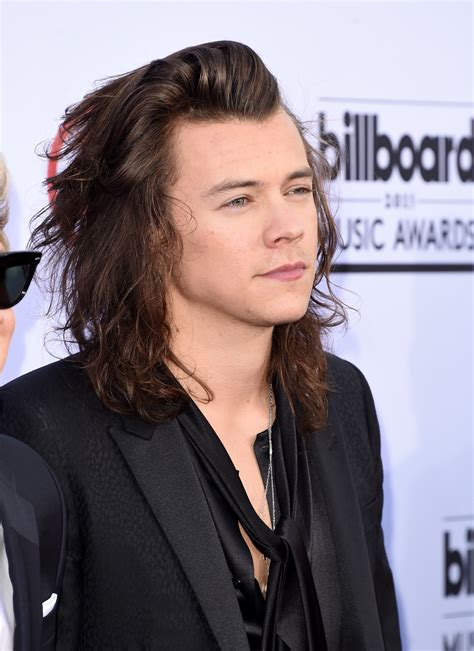 get harry styles hair a year by year history of harry styles s hairstyles photos