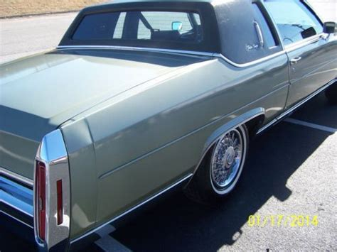 sell   cadillac fleetwood brougham coupe  door