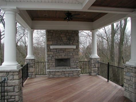 covered porch  stone fireplace